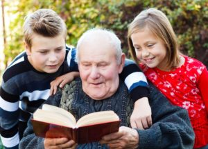 grandfather reading to children